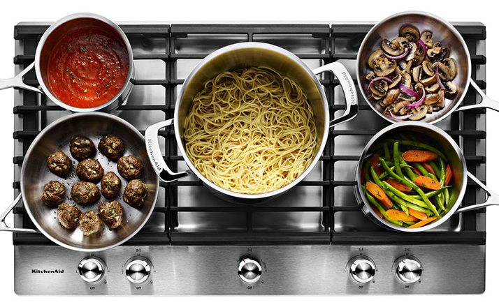 The KitchenAid Five Burner Cooktop is on Fire