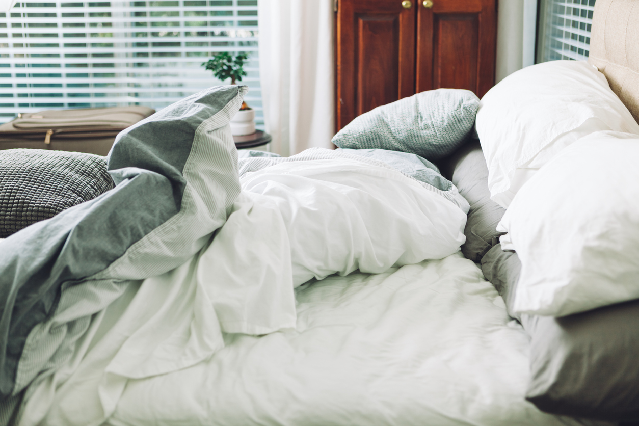 A Rumpled Bed With White Cotton Sheets